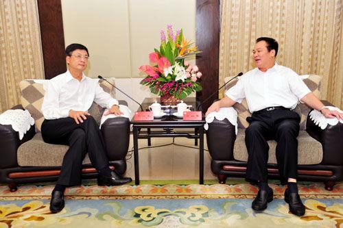 朱明国与中新社社长刘北宪等进行了座谈