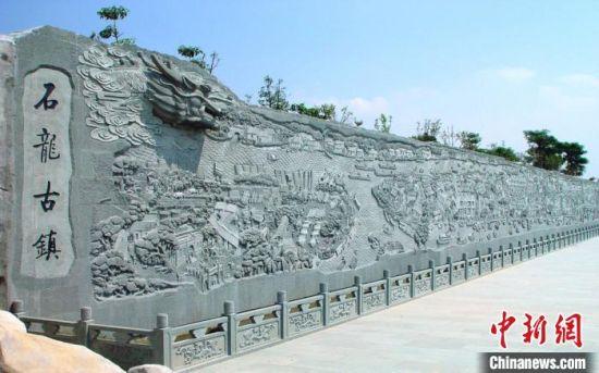 图为广东千年古镇石龙镇文化雕塑 石龙宣 供图